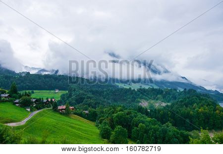 Chalets On Prealps Mountains In Gruyere District In Fribourg Switzerland