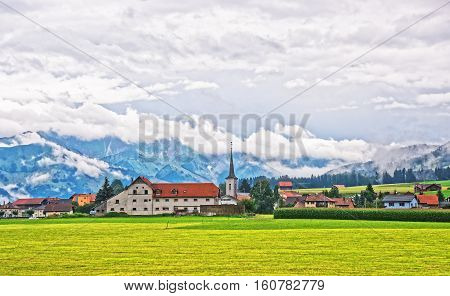 Church of Charmey village on Prealps mountains in Gruyere district Canton Fribourg in Switzerland