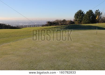 Frost on the fairways and greens of a golf course during early morning