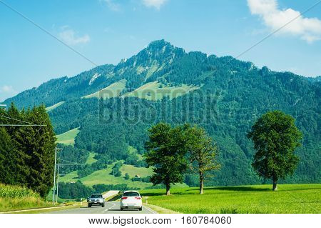 Road and Prealps mountains in Gruyere district Canton Fribourg in Swiss