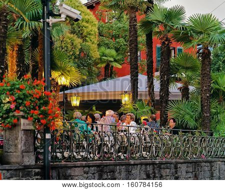 People Dining At Typical Sidewalk Restaurant In Ascona Ticino Switzerland