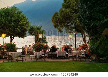 People Dining At Typical Sidewalk Restaurant In Ascona Switzerland