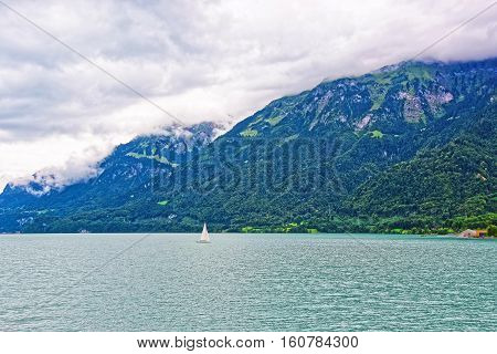 Sailboat In Lake Brienz And Brienzer Rothorn Mountain Bern Switzerland
