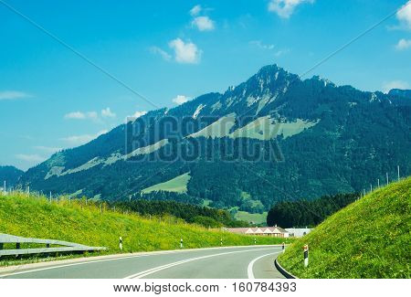 Road And Prealps Mountains In Gruyere Of Fribourg Switzerland