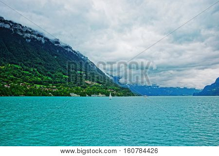 Sailboat On Lake Brienz And Brienzer Rothorn Mountain Bern Swiss