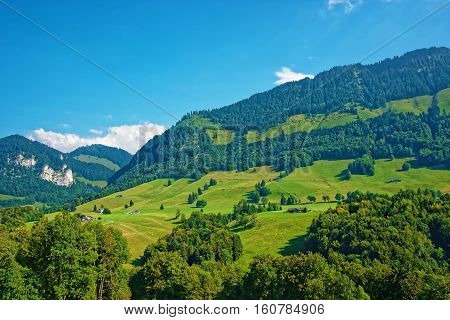 Village At Prealps Mountains In Gruyere District In Fribourg Switzerland