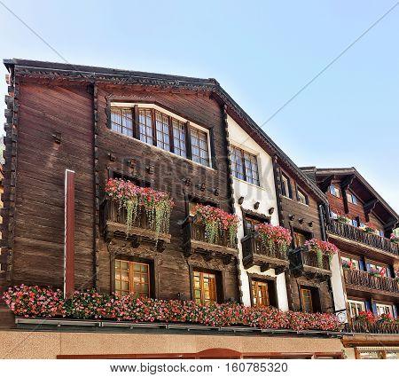 Chalets With Flowers On Balconies In Resort City Zermatt Switzerland