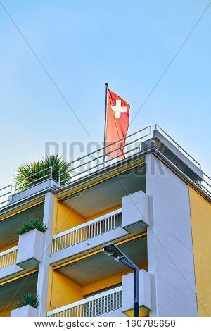 House With Swiss Flag In Ascona Of Ticino In Switzerland