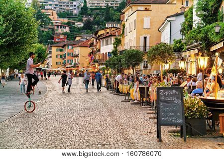 People Relaxing And Dining At Street Restaurants In Ascona