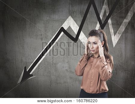 Stressed Woman And Declining Graphs On Blackboard