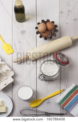 Top view of baking ingredients on a wooden table surface. Concept of baking your own bread and eating healthy