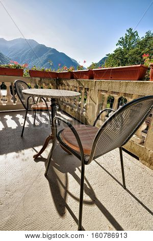 Table With Chairs On The Open Balcony Veranda Swiss