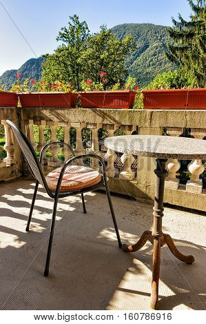 Table With Chairs On The Open Balcony Veranda