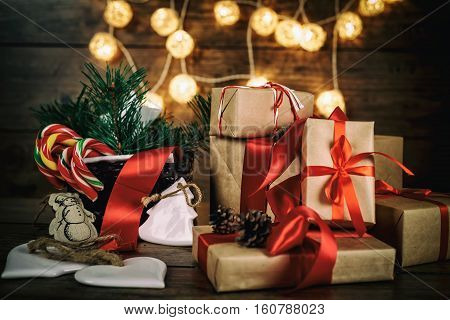 Christmas Gifts with Boxes Coniferous Basket candy cane Cones on Wooden Background Vintage Style with Drawn Snowfall