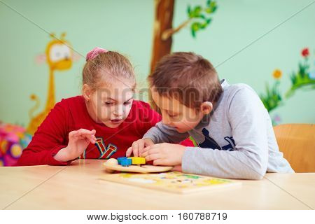 Kids With Special Needs Develop Their Fine Motility In Daycare Rehabilitation Center