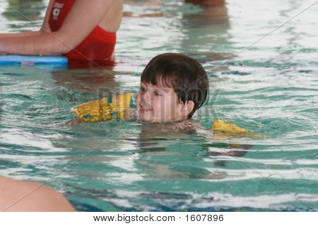 Young Swimming Boy With Floaters