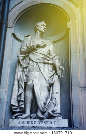 Statue of Amerigo Vespucci the famous Italian explorer financier navigator and cartographer in Uffizi Gallery Florence Italy with sun flare