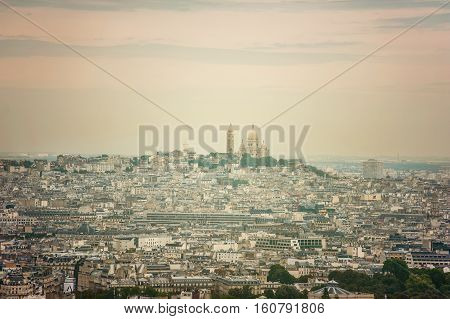 Cityscape skyline view of Paris with the dome of Sacre Coeur Church seen from above with a drone onn a sunny day - aerial photography