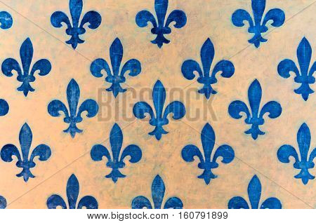 Majestic blue Fleur-de-lis pattern painted on a wall in Palazzo Vecchio - a museum in Florence Italy
