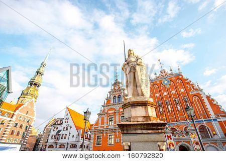 View on the central square with famous houses of Blackheads and Rolands statue in Riga city, Latvia