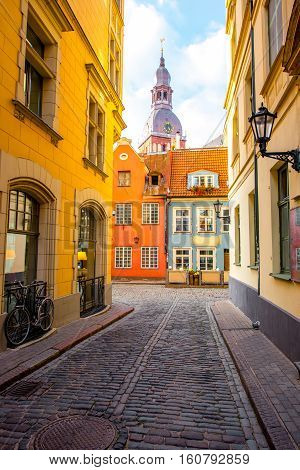 Street view with bell tower of Dome church in the old town of Riga city, Latvia