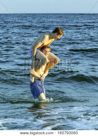 Boys Enjoy The Beautiful Beach   At Dauphin Islands