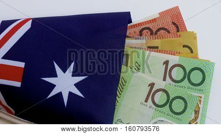 Australian flag with some Australian dollar notes.
