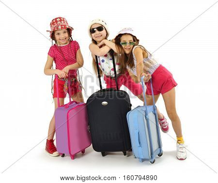 Little fashionable girls turists with suitcases for vacations