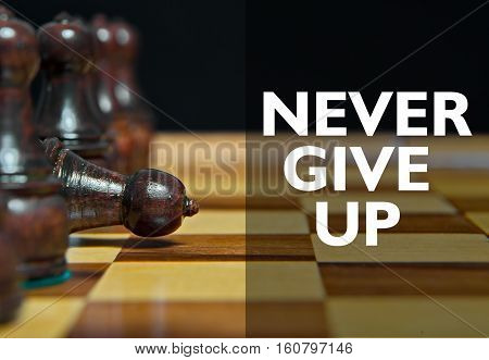 Chess figures on table with Motivational message
