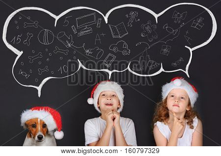Little children and his puppy friend in Sante hat dreaming of the magic Christmas gifts. Merry Christmas concept.