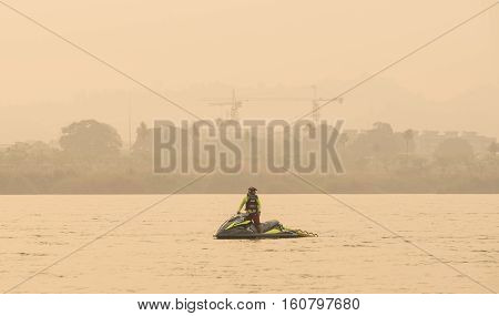 Lifeguard on jetski floating on river wait for rescue sporter in triathlonThailand.