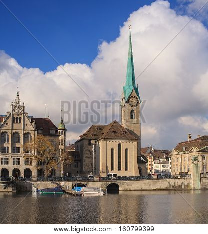 Zurich, Switzerland - 26 November, 2013: the Limmat river, Zurich Town Hall building and Fraumunster Cathedral. Zurich is the largest city in Switzerland and the capital of the Swiss Canton of Zurich.