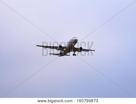 SANTIAGO SPAIN - AUGUST 16: Airplane flying on gray sky on August 16 2016