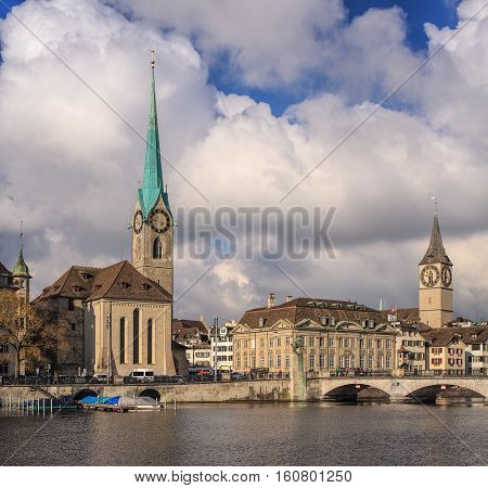 Zurich, Switzerland - 26 November, 2013: the Limmat river, towers of the Fraumunster Cathedral and Saint Peter Church. Zurich is the largest city in Switzerland and the capital of the Swiss Canton of Zurich.