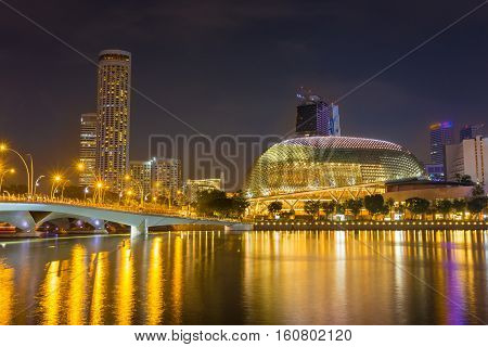 Cityscape of Singapore skyline at night time. Marina Bay is a bay located in the Central Area of Singapore