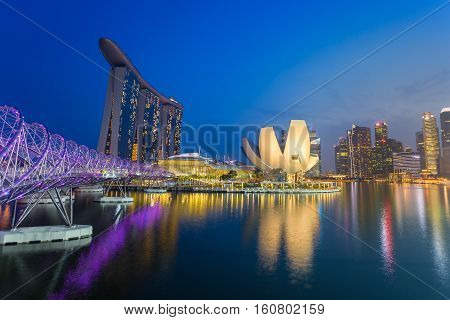 Cityscape of Singapore skyline at twilight time. Marina Bay is a bay located in the Central Area of Singapore