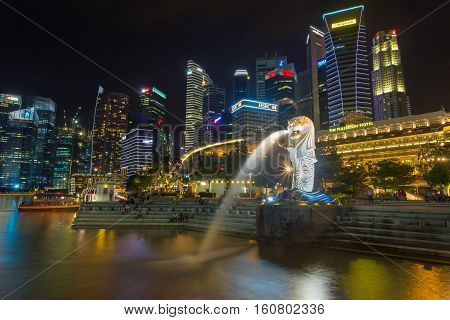 SINGAPORE - NOV 18 2016 : Merlion fountain in front of the Marina Bay Sands hotel on November 182016 in Singapore. Merlion is a imaginary creature with the head of a lion seen a symbol of Singapore