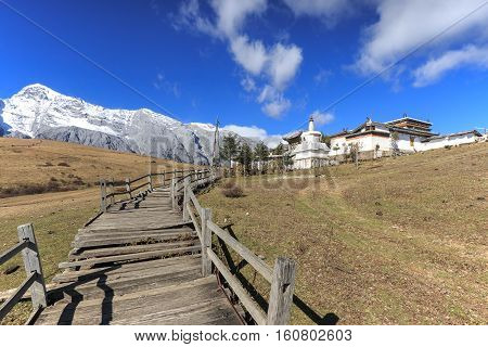 Panoramic view of the Jade Dragon Snow Mountain in Yunnan China and Tibetan Monastery
