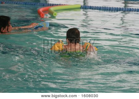 Young Boy Swimming Away