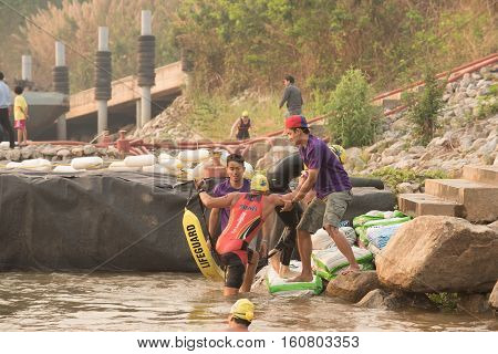 CHIANG RAITHAILAND-APR 32016 : Lifeguard and Triathlon athlete sporter in Golden Triangle Triathlon on April 3 2016 in Chiang sean district Chiang raiThailand.
