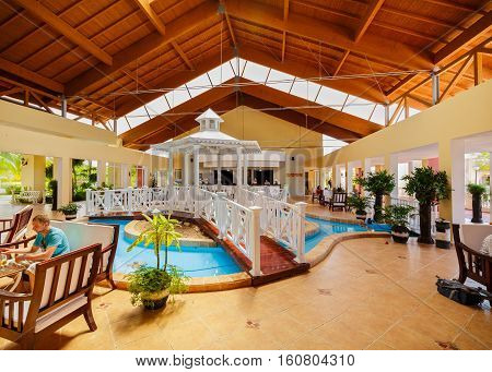 Cayo Coco island, Memories Carib resort, Cuba, June, 26, 2016, amazing gorgeous stylish view of front hotel lobby interior with people wwith people relaxing and enjoying their time