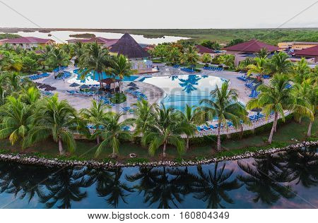 Cayo Coco island, Memories Carib resort, Cuba, June 26, 2016, nice amazing beautiful view of Memories Carib resort grounds, buildings and tropical garden on early morning sunrise time