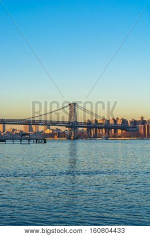 View of the Williamsburg Bridge from northern Brooklyn on the shore os the east river