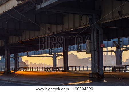 Early Morning view of the east river fro the bike path under the FDR drive