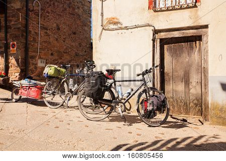 EL ACEBO DE SAN MIGUEL SPAIN - AUGUST 05: Bicycles of pilgrimn parked next to the door during the way of St. James on August 05 2016