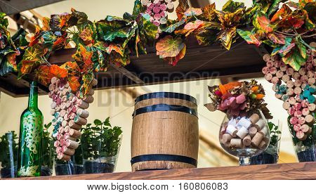 wooden barrel and grape leaves, still life