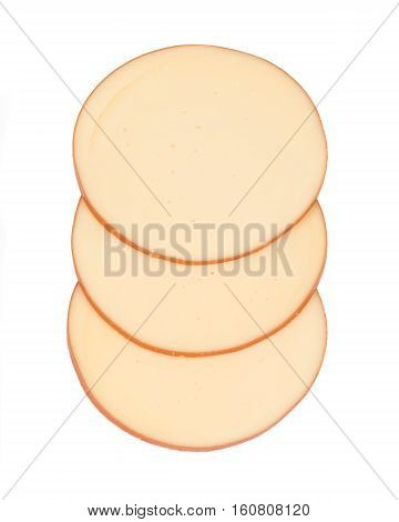 Sliced amish farm organic smoked gouda cheese isolated on white background