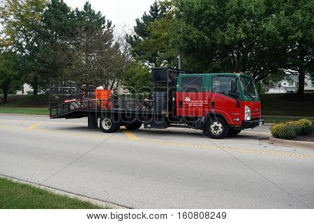 JOLIET, ILLINOIS / UNITED STATES - OCTOBER 5, 2016:  A truck belonging to Ground Pros Inc. is parked on the Wesmere Parkway in Joliet.