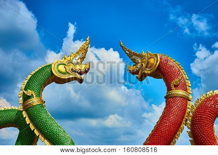 serpent red and green at onece temple , thailand