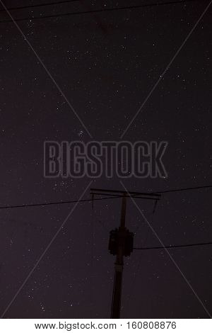 View of the electric pole in the stellar night